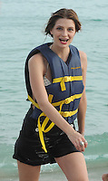 """SMG_FLXX_Mischa Barton_Jet Skiing_010212_06.JPG<br /> <br /> MIAMI BEACH, FL - JANUARY 2 :  Actress Mischa Barton goes jet skiing with red lipstick on her teeth  along with an unidentified man In Miami.  Mischa Anne Marsden Barton (born 24 January 1986) is a British-American fashion model, film, television, and stage actress. She began her acting career on the stage, appearing in Tony Kushner's Slavs! And took the lead in James Lapine's Twelve Dreams at New York's Lincoln Center. She made her screen debut, making a guest appearance on the American soap opera All My Children (1996). She then voiced a character on KaBlam! (1996-1997), an animated television series on Nickelodeon. Her first major film role was as the protagonist of Lawn Dogs (1997), an acclaimed drama co-starring Sam Rockwell. In 1997, she also landed a Calvin Klein campaign. She continued acting, appearing in major box office pictures such as the romantic comedy, Notting Hill (1999) and M. Night Shyamalan's psychological thriller, The Sixth Sense (1999). She later appeared in the independent drama, Lost and Delirious (2001) and played Evan Rachel Wood's girlfriend during a guest-arc on ABC's Once and Again (2001-2002). She is best known for her role as Marissa Cooper in the Fox television series The O.C. (2003-2006), for which she received two Teen Choice Awards and a Prism Award nomination. Entertainment Weekly named her the """"It Girl"""" of 2003.  On December 27, 2011 in Miami Beach, Florida   On January 02, 2012 in Miami Beach, Florida  (Photo By Storms Media Group)   <br /> <br /> People:  Mischa Barton<br /> <br /> Transmission Ref:  FLXX<br /> <br /> Must call if interested<br /> Michael Storms<br /> Storms Media Group Inc.<br /> 305-632-3400 - Cell<br /> 305-513-5783 - Fax<br /> MikeStorm@aol.com"""