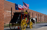 Ft Worth Texas Main Street red stagecoach for tourists to ride near The Stockyard famous for the Longhorn herds that come thru town with Cowboys   2
