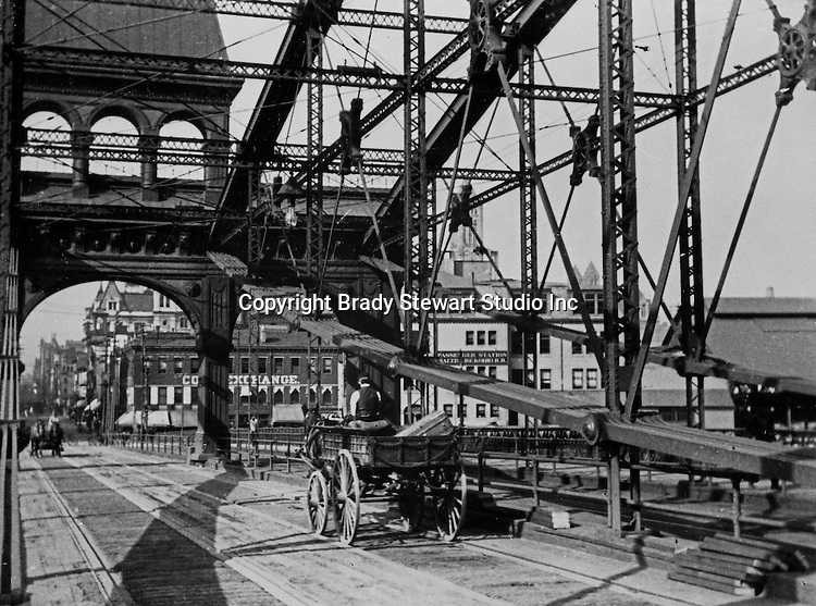 Pittsburgh PA:  Horse-drawn wagon delivering baggage from the Pennsylvania and Lake Erie RR station to Pittsburgh hotels.