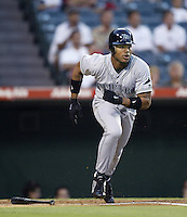 Carl Crawford of the Tampa Bay Devil Rays runs to first base during a 2002 MLB season game against the Los Angeles Angels at Angel Stadium, in Los Angeles, California. (Larry Goren/Four Seam Images)