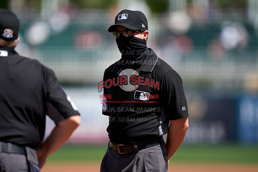 Umpire Junior Valentine before a Major League Spring Training game between the Pittsburgh Pirates and Minnesota Twins on March 16, 2021 at Hammond Stadium in Fort Myers, Florida.  (Mike Janes/Four Seam Images)