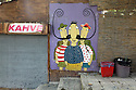 Colorful graffiti cartoon art in Istanbul depicting a threesome sharing large handlebar moustache.