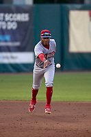 Clearwater Threshers shortstop Luis García (5) flips the ball to second base to start a double play during a game against the Fort Myers Mighty Mussels on May 12, 2021 at Hammond Stadium in Fort Myers, Florida.  (Mike Janes/Four Seam Images)