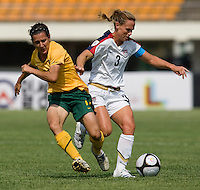 USWNT defender (3) Christie Rampone takes the ball away from Australia's (11) Lisa DeVanna during the Peace Queen Cup  in Suwon, South Korea.  The U.S. defeated Australia, 2-1, at the Suwon Sports Complex.