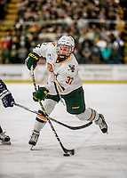 10 February 2017: University of Vermont Catamount Forward Ross Colton, a Freshman from Robbinsville, NJ, takes a second period slap shot against the University of New Hampshire Wildcats at Gutterson Fieldhouse in Burlington, Vermont. The Catamounts fell to the Wildcats 4-2 in the first game of their 2-game Hockey East Series. Mandatory Credit: Ed Wolfstein Photo *** RAW (NEF) Image File Available ***