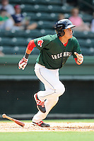 Second baseman Hector Lorenzana (20) of the Greenville Drive bats in a game against the Asheville Tourists on Sunday, July 20, 2014, at Fluor Field at the West End in Greenville, South Carolina. Lorenzana was a 2014 draft pick of the Boston Red Sox out of the University of Oklahoma. Asheville won game one of a doubleheader, 3-1. (Tom Priddy/Four Seam Images)