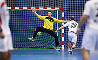 08 JAN 2012 - LONDON, GBR - Great Britain goalkeeper Jesper Parker (#1, in yellow and black) tries to save a penalty from Austria's Robert Webber (#28, in white) during the men's 2013 World Handball Championships qualification match at the National Sports Centre in Crystal Palace, Great Britain (PHOTO (C) 2012 NIGEL FARROW)