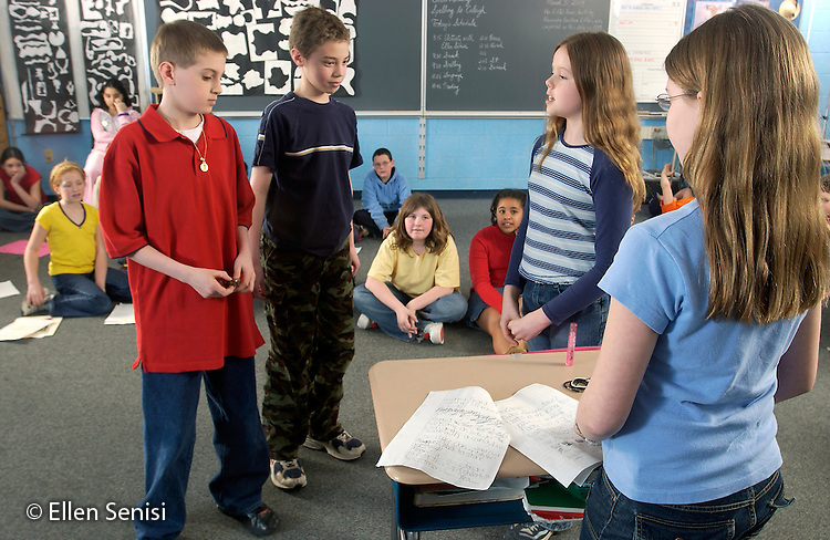Schenectady, NY.Hillside School, Niskayuna School District, Grade 5.Students role-play for character education lesson; curriculum emphasizes empathy, tolerance, diversity, and conflict resolution.  In this skit, two students (boys left) steal an item (shop lift) and are questioned by student role-playing store manager..©Ellen B. Senisi