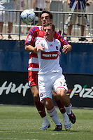 Chicago Fire midfielder Stephen King (33) beats FC Dallas midfielder Andre Rocha (11) to the ball. Chicago Fire vs FC Dallas at Pizza Hut Park Frisco, Texas June-15-2008.  FC Dallas 1, Chicago 0.