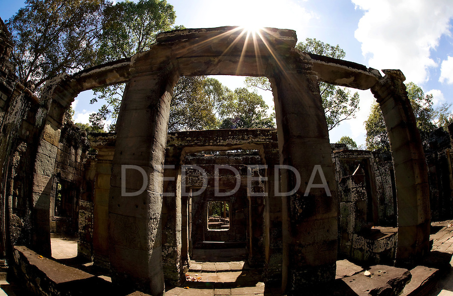 A temple is backlit by the sun in the ancient city of Angkor Thom, in northwestern Cambodia near Siem Reap.