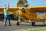 Piper J3 Cub running up at 2014 Hood River Fly-In at WAAAM.