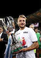 Calcio, Football - Juventus vs Lazio Italian Super Cup Final  <br /> Lazio's Ciro Immobile celebrates with the trophy after winning the Italian Cup Final match at Rome's Olympic stadium, on August 13, 2017.<br /> UPDATE IMAGES PRESS/Isabella Bonotto