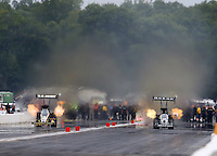 Aug 17, 2014; Brainerd, MN, USA; NHRA top fuel dragster driver Tony Schumacher (left) races alongside Shawn Langdon during the Lucas Oil Nationals at Brainerd International Raceway. Mandatory Credit: Mark J. Rebilas-