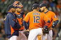 Houston Astros manager Bo Porter on the mound with catcher Carlos Corporan, Carlos Pena (12) and Marwin Gonzalez during the MLB baseball game against the Detroit Tigers on May 3, 2013 at Minute Maid Park in Houston, Texas. Detroit defeated Houston 4-3. (Andrew Woolley/Four Seam Images).