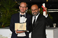 CANNES, FRANCE. July 17, 2021: Juho Kuosmanen & Asghar Farhadi at the photocall for Cannes Awards 2021 at the 74th Festival de Cannes.<br /> Picture: Paul Smith / Featureflash