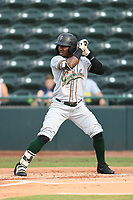 Greensboro Grasshoppers Rodolfo Castro (7) bats during a game with the Hickory Crawdads at L.P. Frans Stadium on May 27, 2019 in Hickory, North Carolina.  The Grasshoppers defeated the Crawdads 8-2. (Tracy Proffitt/Four Seam Images)