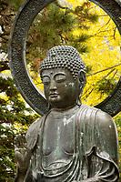 Japanese Tea Garden in Golden Gate Park, San Francisco, California. Bronze statue of Buddha.
