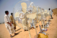 Fans are distributed among refugees at the Swabi Refugee camp. The camp is run by Red Cross/Red Crescent (ICRC), and currently houses around 18,000 refugees. The Pakistani government began an offensive against the Taliban in the Swat Valley in April 2009, which led to a major humanitarian crisis. Up to two million civilians were estimated to have been displaced by the fighting.