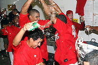 September 15 2008:  Jairo Martinez, Arquimedes Nieto, Miguel Tapia of the Batavia Muckdogs, Class-A affiliate of the St. Louis Cardinals, celebrate winning the NY-Penn League championship after a game at Dwyer Stadium in Batavia, NY.  Photo by:  Mike Janes/Four Seam Images