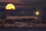 Novembers full moon rising over Alcatraz Island, San Francisco.