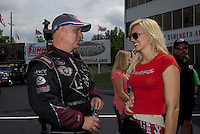 May 11, 2013; Commerce, GA, USA: NHRA funny car driver Tim Wilkerson (left) talks with Courtney Force during the Southern Nationals at Atlanta Dragway. Mandatory Credit: Mark J. Rebilas-