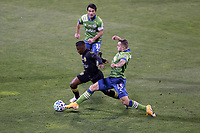 COLUMBUS, OH - DECEMBER 12: Jordan Morris #13 of the Seattle Sounders FC tries to knock the ball away from Luis Diaz #12 of the Columbus Crew during a game between Seattle Sounders FC and Columbus Crew at MAPFRE Stadium on December 12, 2020 in Columbus, Ohio.