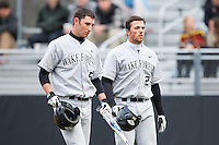 Evan Stephens (5) and Charlie Morgan (24) of the Wake Forest Demon Deacons walk back to the dugout following Morgan's 2-run home run against the Davidson Wildcats at Wilson Field on March 19, 2014 in Davidson, North Carolina.  The Wildcats defeated the Demon Deacons 7-6.  (Brian Westerholt/Four Seam Images)