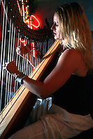 Danielle Summerville plays harp during the Ocean Beach chapter of Amnesty International second annual musical festival fundraiser, Saturday, July 12, 2008 at Portugalia restaurant in Ocean Beach.