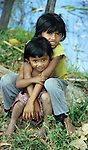 Cambodian Children 02 - Two young girls sitting on the roadside, Siem Reap, Cambodia