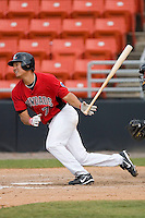 Jason Ogata #7 of the Hickory Crawdads follows through on his swing versus the West Virginia Power at L.P. Frans Stadium June 21, 2009 in Hickory, North Carolina. (Photo by Brian Westerholt / Four Seam Images)