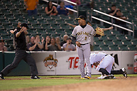 Salt Lake Bees third baseman Jose Miguel Fernandez (9) reacts after applying a late tag to Jon Kemmer (25) during a Pacific Coast League game against the Fresno Grizzlies at Chukchansi Park on May 14, 2018 in Fresno, California. Fresno defeated Salt Lake 4-3. (Zachary Lucy/Four Seam Images)