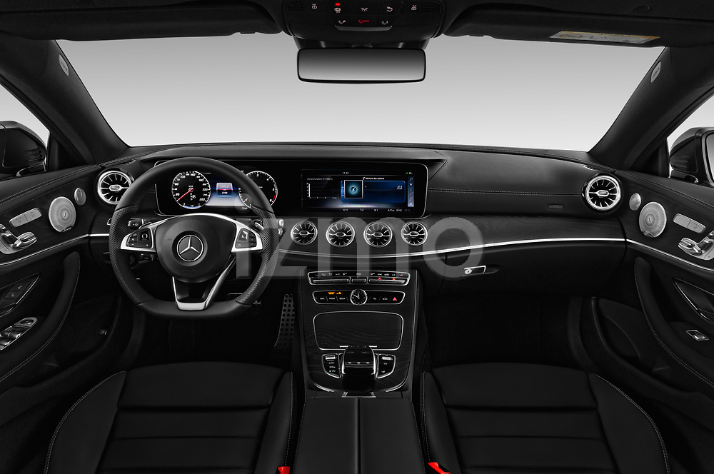 Stock photo of straight dashboard view of 2017 Mercedes Benz E Class AMG Line 2 Door Coupe