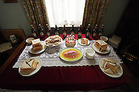 Swansea, UK. Saturday 25 October 2014<br /> Pictured: Marmite and spam sandwiches, welsh cakes and other food stuff for an afternoon tea at Dylan Thomas' birth place.<br /> Re: Dylan Thomas birthday centenary celebrations at his birthplace, 5 Cwmdonkin Drive, Swansea, south Wales.