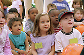 Children watch a performance at a Healthy Living Day organised by Camden Sure Start.