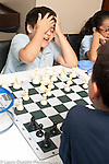 Education chess afterschool program boy reacting to move
