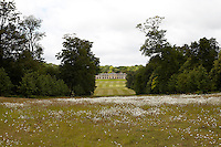 The Kennels at Goodwood seen across the park from the main house