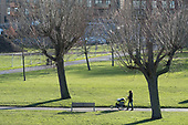 Woman with a pram. Burgess Park, Southwark.