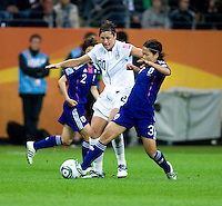 Abby Wambach, Azusa Iwashimizu.  Japan won the FIFA Women's World Cup on penalty kicks after tying the United States, 2-2, in extra time at FIFA Women's World Cup Stadium in Frankfurt Germany.