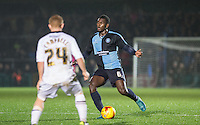 Aaron Pierre of Wycombe Wanderers takes on a player during the Sky Bet League 2 match between Wycombe Wanderers and Notts County at Adams Park, High Wycombe, England on 15 December 2015. Photo by Andy Rowland.
