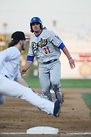 D.J. Peters (31) of the Rancho Cucamonga Quakes begins a slide into third base during a game against the Lancaster JetHawks at The Hanger on April 28, 2017 in Lancaster, California. Lancaster defeated Rancho Cucamonga, 16-10. (Larry Goren/Four Seam Images)