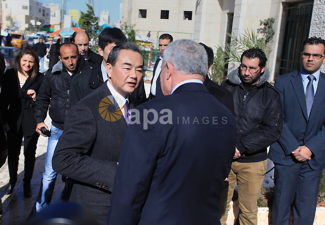 Chinese Foreign Minister Wang Yi shakes hands with his Palestinian counterpart Riad Malki upon his arrival in the West Bank city of Ramallah December 18, 2013. Photo by Issam Rimawi