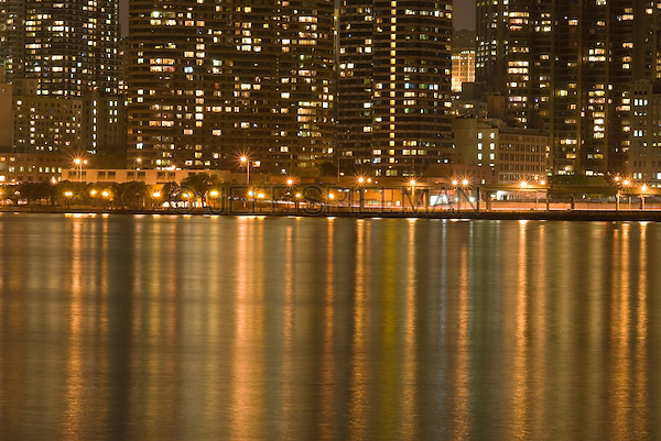 Buildings on Manhattan's East Side and the East River Illuminated at Night, New York City, New York State, USA
