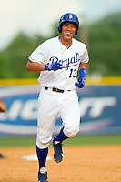 Pedro Gonzalez (13) of the Burlington Royals rounds the bases after hitting a pinch-hit 2-run home run against the Princeton Rays at Burlington Athletic Park on July 5, 2013 in Burlington, North Carolina.  The Royals defeated the Rays 5-1 in game one of a doubleheader.  (Brian Westerholt/Four Seam Images)
