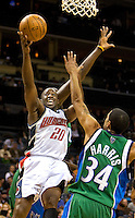 Charlotte Bobcats Raymond Felton goes in for a shot against the Dallas Mavericks during an NBA basketball game Time Warner Cable Arena in Charlotte, NC.