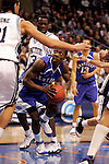 Kentucky guard Ramel Bradley (3) looks towards the basket while being defended by Connecticut center Josh Boone (21).  Connecticut defeated Kentucky 87-83 in the second round of the NCAA Tournament  at the Wachovia Center in Philadelphia, Pennsylvania on March 19, 2006.
