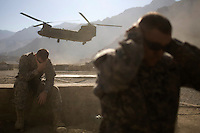 A soldier covers his ears as a helicopter takes off at Forward Operating Base Blessing in the Pesh Valley. F Company, 201st Brigade Support Battalion had to re-supply the base by road but it also receives supplies by helicopter. The unit often get attacked by Taliban fighters along this valley as they attempt to re-supply several bases in this pro-Taliban region, which sees some of the heaviest fighting in Afghanistan.