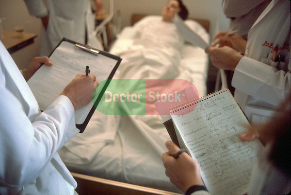 doctors examining patient in hospital