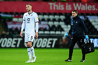 Mike van der Hoorn of Swansea City leaves the pitch injured during the Sky Bet Championship match between Swansea City and Charlton Athletic at the Liberty Stadium in Swansea, Wales, UK.  Thursday 02 January 2020