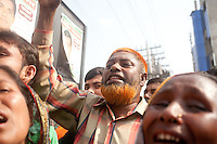 A man shouts slogans during a protest organized by Bangladeshi garments workers, relatives and activists.   Relatives of victims with thousands of people gather at the Rana Plaza collapse site today to commemorate the tragedy that happened one year ago.