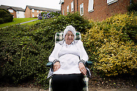 Mrs Taub poses for a portrait on the lawn outside her rented house. She is mother of 11 children, and grandmother of 'endless children'. Hasidic families stay in Pentre Jane Morgan university accommodation when they holiday in Aberystwyth. Every other day, bread, milk and other supplies are brought from Kosher shops in London and resold from one of the rented houses on the campus.